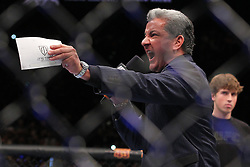 Las Vegas, NV - December 29, 2012: Bruce Buffer introduces Cain Velasquez at UFC 155 at MGM Grand Garden Arena in Las Vegas, Nevada.