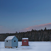 Ice fishing shacks on Eagle Lake  Acadia National Park await their intrepid  occupants. The park is a meeting place for sportsman and helps support traditional activities. It's a typical midwinter morning in downeast Maine with the temperature at 1 degree F and a wind chill of -15F.