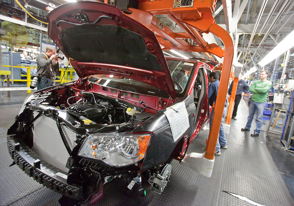 Workers on the production line at Chrysler's plant in Windsor, Ontario, assemble one of the company's new minivans January 18, 2011 as the company celebrated the production launch of the new Dodge Grand Caravan and Chrysler Town and Country.<br /> The Canadian Press/GEOFF ROBINS