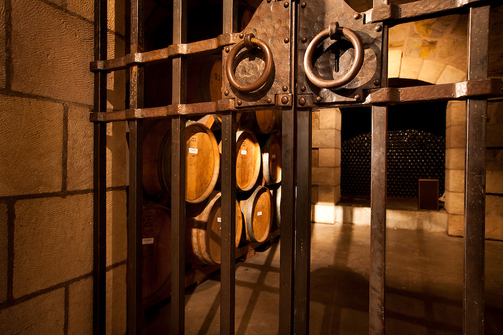 Wine barrels in locked wine cellar
