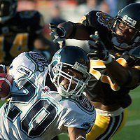 Toronto Argos running back John Avery gets tripped up tries to turn the corner to elude Ticat defensive back Chris Martin during first half CFL action at Ivor Wynne Stadium Sept. 6.&amp;#xD;<br />