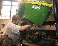 Lafayette High students Jonathan Arbuckle troubleshoot tractor problems during the Northwest Federation FFA District Competitions at The Oxford-Lafayette School of Applied Technology on Friday, March 12, 2010..  OLSAT expected over 274 students, advisors, parents, and visitors on campus.