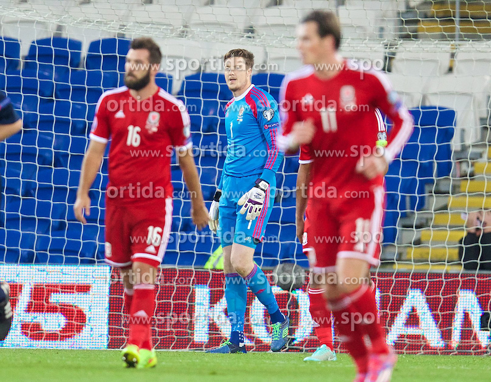 13.10.2014, City Stadium, Cardiff, WAL, UEFA Euro Qualifikation, Wales vs Zypern, Gruppe B, im Bild Wales' goalkeeper Wayne Hennessey looks dejected as Cyprus score a goal // 15054000 during the UEFA EURO 2016 Qualifier group B match between Wales and Cyprus at the City Stadium in Cardiff, Wales on 2014/10/13. EXPA Pictures &copy; 2014, PhotoCredit: EXPA/ Propagandaphoto/ David Rawcliffe<br /> <br /> *****ATTENTION - OUT of ENG, GBR*****