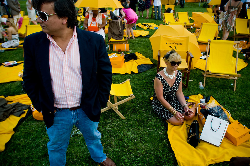 Carlos T Fernandez and Avril Graham watching the 2009 Veuve Clicquot Manhattan Polo Classic on Governor's Island, where Britain's Prince Harry is competing.
