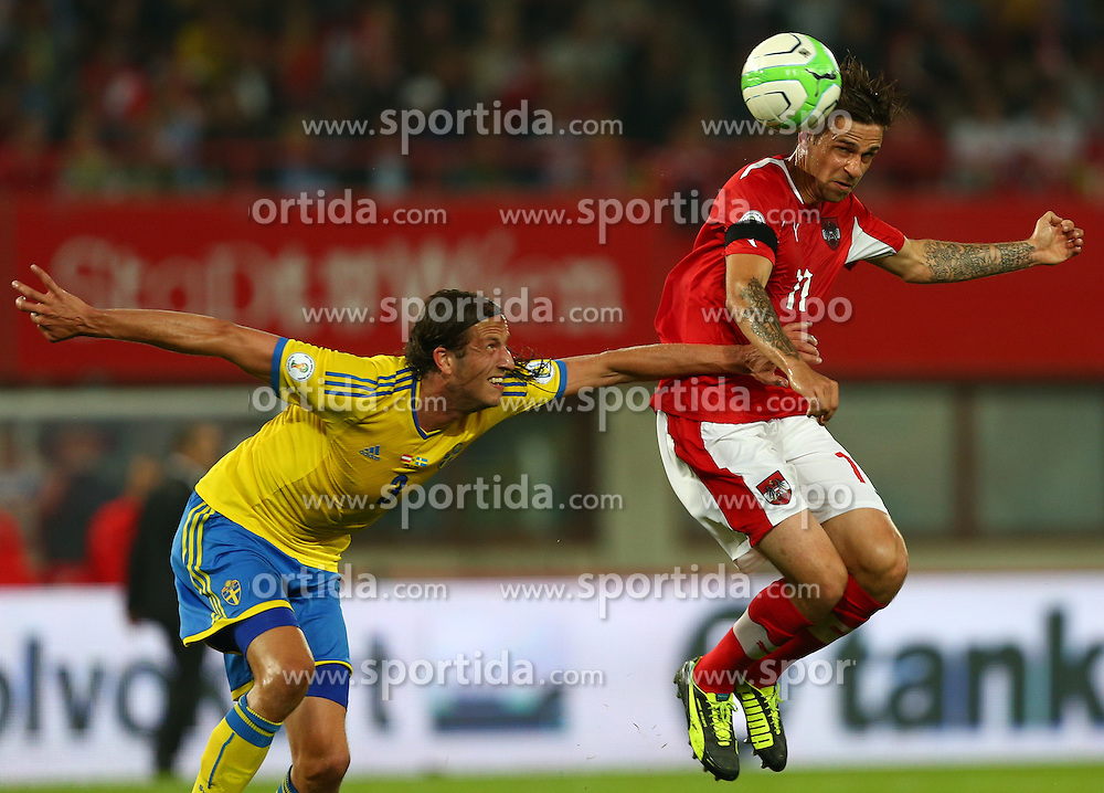 07.06.2013, Ernst Happel Stadion, Wien, AUT, FIFA WM Qualifikation, Oesterreich vs Schweden, im Bild Jonas Olsson, (SWE, #3) und Martin Harnik, (AUT, #11)  // during the FIFA World Cup Qualifier Match between Austria and Sweden at the Ernst Happel Stadium, Vienna, Austria on 2013/06/07. EXPA Pictures © 2013, PhotoCredit: EXPA/ Thomas Haumer