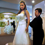 Lisa Gottlieb, 27, from Brookville, Long Island, NY glances back at Tara Sipper, 26, from West Caldwell, New Jersey as they try on wedding gowns at Kleinfeld, the legendary New York City wedding store.