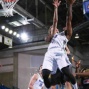 Reno Bighorns Guard Ra'shad James (10) drives towards the basket as Delaware 87ers Forward Joonas Caven (24) defends in the second half of a NBA D-league regular season basketball game between the Delaware 87ers and the Reno Bighorns (Sacramento Kings), Tuesday, Feb. 10, 2015 at The Bob Carpenter Sports Convocation Center in Newark, DEL