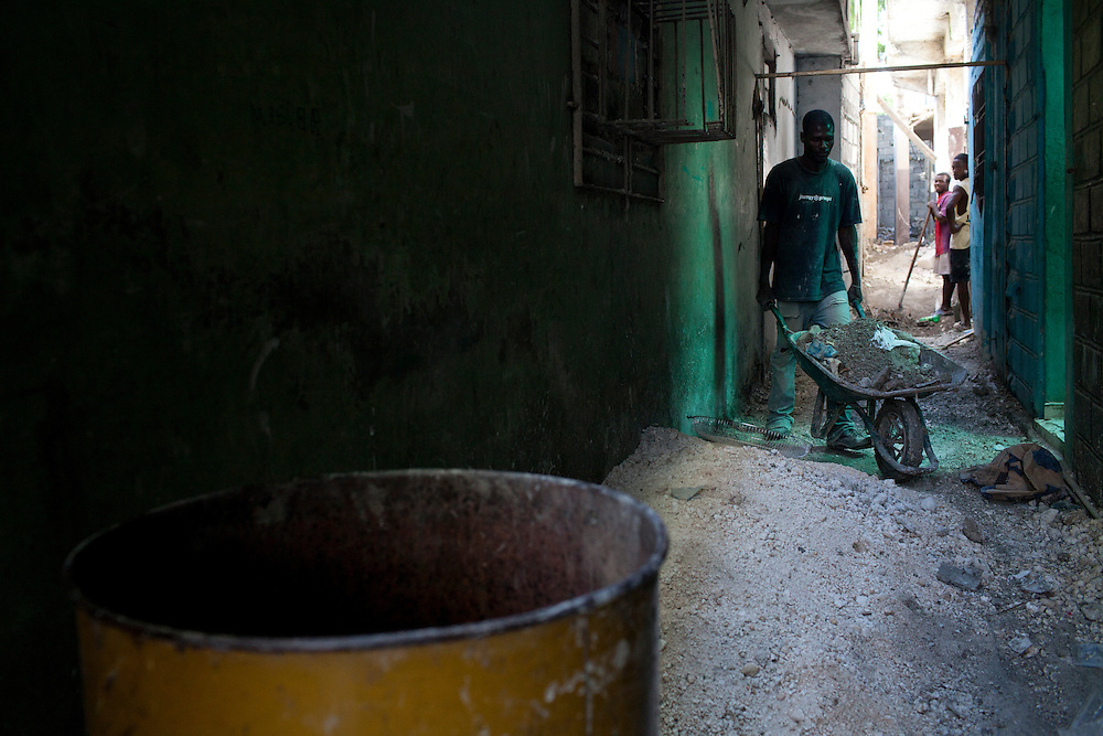 A man takes a wheelbarrow full of rubble out of a building on July 6, 2010 in Port-au-Prince, Haiti. Nearly all the cleanup is being done by hand.