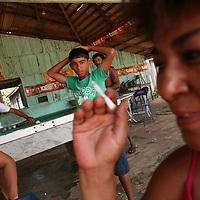 A woman smokes a cigarette in roadside bar in Marcelândia, in Mato Grosso state, in Brazil on April 6, 2008. (Photo/Scott Dalton).