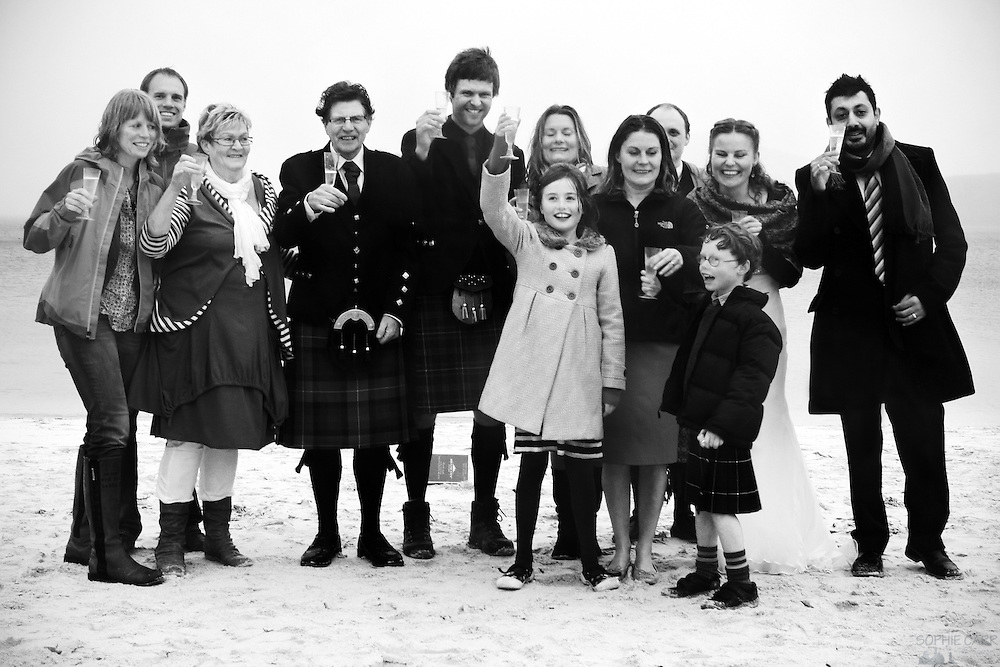 The Bakkers and the Beaumonts on Vatersay Beach in the rain