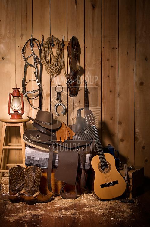 Still life of cowboy paraphernalia in the tack room of a barn