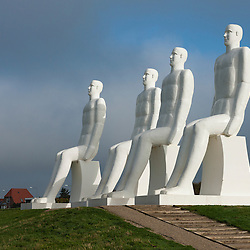 The Men at Sea is a 9 metre (30 feet) tall white monument of four seated males, located west of Esbjerg next to S&aelig;dding Beach on the southwest coast of Denmark. Located opposite the Fisheries and Maritime Museum, it is one of the area's major tourist attractions, and is a famous landmark of Esbjerg.<br /> <br /> The sculpture was designed by Svend Wiig Hansen and installed on 28th October 1995. It was funded by the municipality of Esbjerg, the Kunstfond (an art fund), and private sponsors, to celebrate the 100th anniversary of the municipality in 1994.