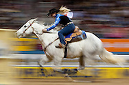 Tammy Fischer, competes in the  9th go-round of barrel racing at the 2009 Wrangler National Finals Rodeo in Las Vegas, Nevada. Photograph © 2009 Darren Carroll