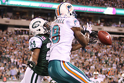 October 17, 2011; East Rutherford, NJ, USA; New York Jets cornerback Darrelle Revis (24) breaks up a pass intended for Miami Dolphins wide receiver Brandon Marshall (19) during the first half at the New Meadowlands Stadium.