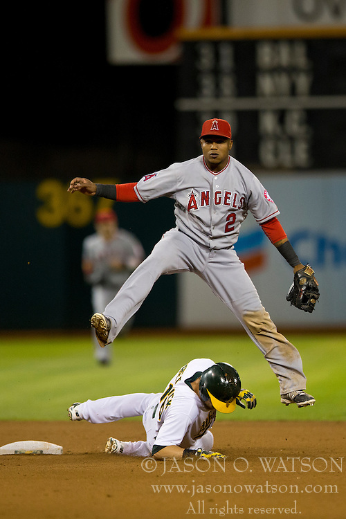 OAKLAND, CA - SEPTEMBER 23:  Erick Aybar #2 of the Los Angeles Angels of Anaheim completes a double play over Josh Reddick #16 of the Oakland Athletics during the seventh inning at O.co Coliseum on September 23, 2014 in Oakland, California. The Los Angeles Angels of Anaheim defeated the Oakland Athletics 2-0.  (Photo by Jason O. Watson/Getty Images) *** Local Caption *** Erick Aybar; Josh Reddick