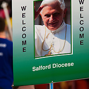 Banner of Pope at Hyde Park rally during Pope Benedict XVI's papal tour of Britain 2010, the first visit by a pontiff since 1982. Taxpayers footed the £10m bill for non-religious elements, which largely angered a nation still reeling from the financial crisis. Pope Benedict XVI is the head of the biggest Christian denomination in the world, some one billion Roman Catholics, or one in six people. In Britain there are about five million Catholics but only a quarter of Catholics regularly attend Sunday Mass and some churches have closed owing to spending cuts.