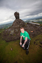 Alan Clark on his charity walk with two 24kg kettlebells for Macmillan Cancer Support, up and down Dumyat, the 418 metres high hill at the western edge of the Ochil Hills in central Scotland.