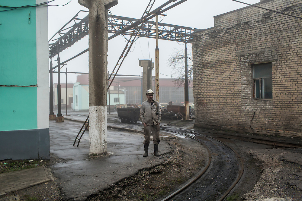 A miner stands outside on the territory of the Shcheglovskaya Coal Mine on Friday, March 25, 2016 in Makiivka, Ukraine.