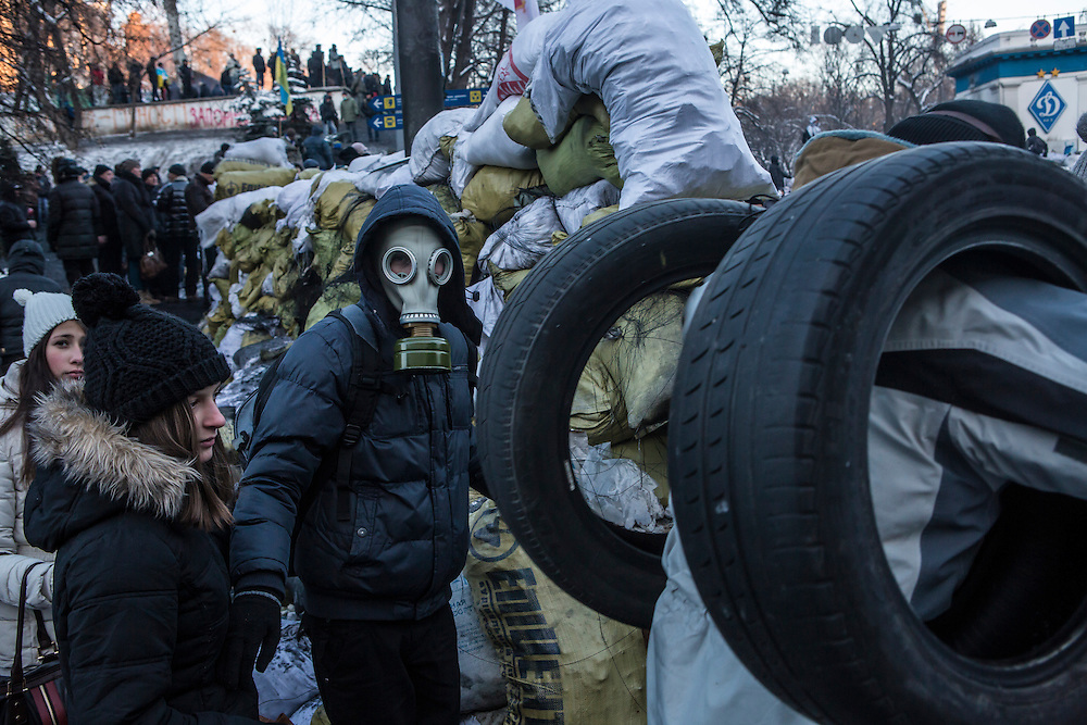 KIEV, UKRAINE - JANUARY 24: Anti-government protesters pass through an opening in a barricade near Dynamo stadium on January 24, 2014 in Kiev, Ukraine. After two months of primarily peaceful anti-government protests in the city center, new laws meant to end the protest movement have sparked violent clashes in recent days. (Photo by Brendan Hoffman/Getty Images) *** Local Caption ***