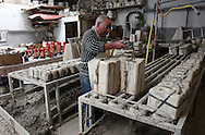 Francisco Silva filling moulds with ceramic phallus created by himself in his atelier at Chao da Parada, in Caldas da Rainha city. He is one of the last artisans of this kind of erotic pottery  traditional to Caldas da Rainha, in the center region of Portugal.