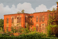 Middletown, New York - Sunlight shines on an abandoned building at the former Middletown Psychiatric Center after a thunderstorm on May 27, 2015.
