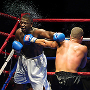 (LtoR) Emanuel Laurent takes a left to the jaw by Portland's Joe Guzman who won their four-round decision at the Rose Gardenn.