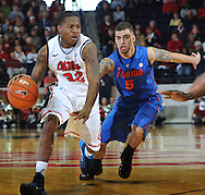 "Mississippi's Jarvis Summers (32) dibbles against Florida's Scottie Wilbekin (5) at the C.M. ""Tad"" Smith Coliseum in Oxford, Miss. on Saturday, February 22, 2014. (AP Photo/Oxford Eagle, Bruce Newman)"