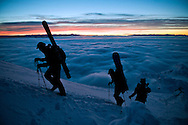 Kent Werlin, Matt Lucia and Nick Fouts climb the last few feet to the summit of Mt. Glory recently as an inversion blankets the valley just before sunrise.