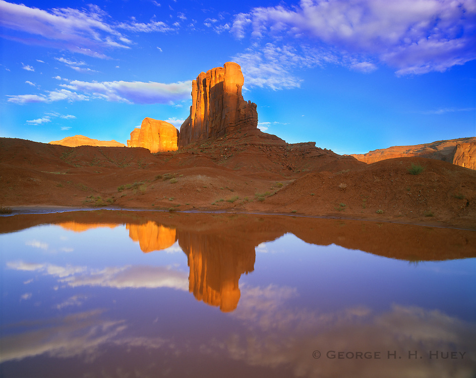 0195-1054 ~ Copyright: George H. H. Huey ~ Monument Valley. Reflection of Camel Butte in rainwater pool. Monument Valley Tribal Park, Arizona.