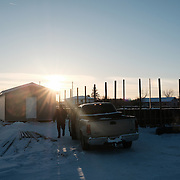 Leadership councilor Fabian Blackhawk returning to his truck after checking on the progress an outdoor ice hockey ring being constructed at the Ochiichagwe'Babigo'Ining Ojibway Nation reserve (also known as the Dalles First Nation) in Northern Ontario, Canada on 15 December 2016. The rink is one of a number of initiatives to provide the community's young people with healthy entertainment.