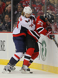Jan 25, 2013; Newark, NJ, USA; Washington Capitals defenseman John Carlson (74) hits New Jersey Devils center Ryan Carter (20) during the first period at the Prudential Center.