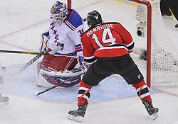 May 19, 2012; Newark, NJ, USA; New York Rangers goalie Henrik Lundqvist (30) makes a save on New Jersey Devils center Adam Henrique (14) during the second period in game three of the 2012 Eastern Conference Finals at the Prudential Center.