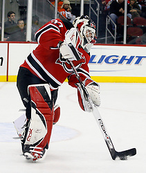 November 8, 2007; Newark, NJ, USA;  New Jersey Devils goalie Martin Brodeur (30) clears the puck out of the zone during the third period of their game against the Philadelphia Flyers at the Prudential Center in Newark, NJ.  The Devils won the game by a 4-1 score.  The win was the 499th of Martin Brodeur's career.