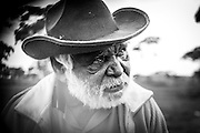 Dinny Smith is a Panagka man born with the traditional name Kuyayina in the desert region of Jameson (Mantamaru). His language is Ngaanyatjarra.  <br /> Dinny spent some time in his working life at various stations and missions and integrated his traditional spiritual beliefs.  Dinny practiced the ancient skills of tool-making, creating spears, woomeras, shields, boomerangs and warti. His fundamental belief is that educating the future generations is necessary in order to learn both life skills and retain traditional culture. He lived at Ninga Mia Aboriginal Community and used to come into the town of Kalgoorlie-Boulder to busk and share his culture by singing traditional songs about hunting and country. Dinny is an award-winning artist whose paintings feature waterholes, animal tracks and communities around his traditional lands. Dinny is now residing at Ngurra Kampi and is one of the country's most respected Elders.<br /> <br /> Extract from interview conducted with Monika Dvorakova from the Bush Blossom Gallery.