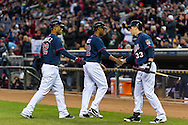 Aaron Hicks #32 of the Minnesota Twins celebrates with teammates Wilkin Ramirez #22 and Justin Morneau #33 after scoring during a game against the Los Angeles Angels on April 16, 2013 at Target Field in Minneapolis, Minnesota.  The Twins defeated the Angels 8 to 6.  Photo: Ben Krause