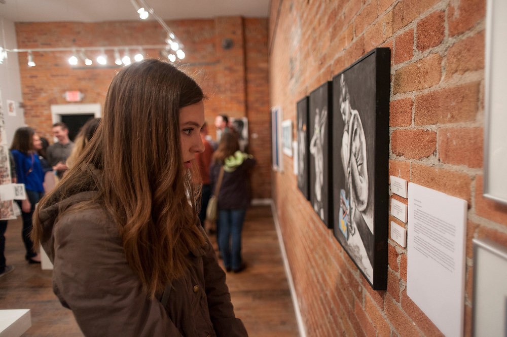 Community members enjoy Gonzaga artwork at the Senior Art Show at Richmond Art Collective on Friday, April 8th, 2017.