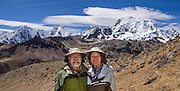 Tom and Carol pose in front of Yerupaja Grande (6635 m or 21,770 ft), Peru's second highest peak. Center left is Mount Jirishanca (Icy Beak of the Hummingbird, 6126 m or 20,098 feet). Day 8 of 9 days trekking around the Cordillera Huayhuash in the Andes Mountains, LLamac, Peru, South America. For licensing options, please inquire.