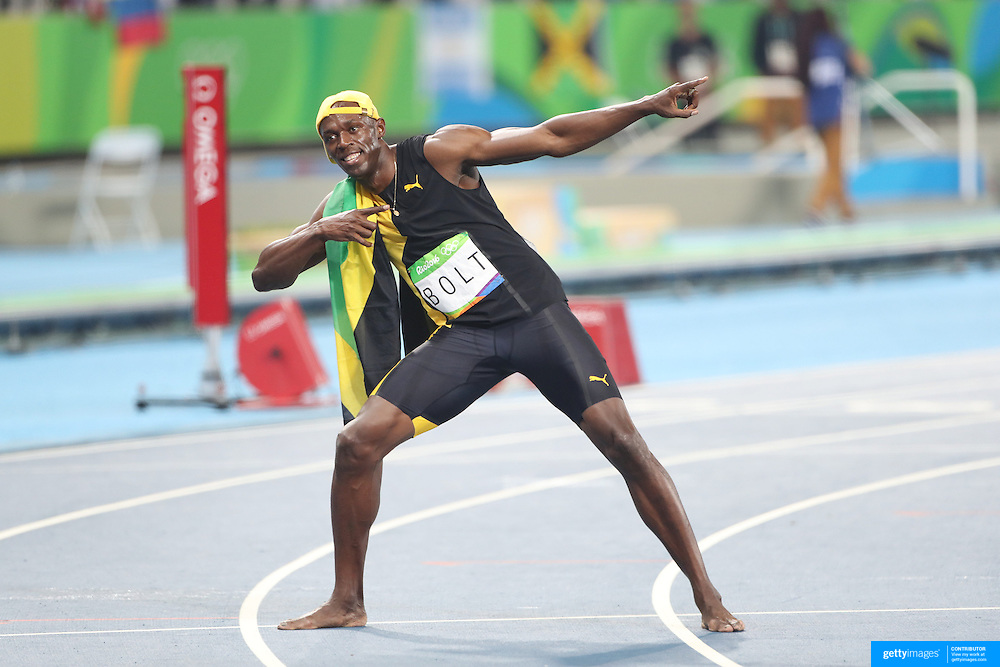 Athletics - Olympics: Day 9  Usain Bolt of Jamaica strikes his 'Lightening Bolt' pose after winning the Men's 100m Final at the Olympic Stadium on August 14, 2016 in Rio de Janeiro, Brazil. (Photo by Tim Clayton/Corbis via Getty Images)