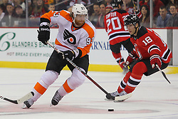 Mar 13, 2013; Newark, NJ, USA; Philadelphia Flyers right wing Jakub Voracek (93) skates with the puck past New Jersey Devils right wing Steve Bernier (18) during the second period at the Prudential Center.
