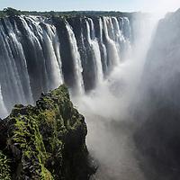 Africa, Zimbabwe, Victoria Falls National Park, Zambezi River as it flows over Victoria Falls