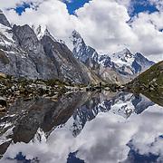 Mount Jirishanca (Icy Beak of the Hummingbird, 6126 m or 20,098 feet) reflects in a stream pond in the Cordillera Huayhuash, Andes Mountains, Peru, South America. Day 3 of 9 days trekking around the Cordillera Huayhuash.