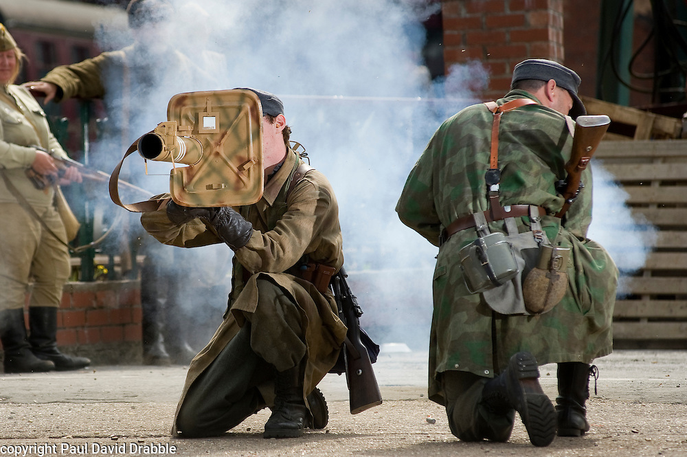 Reenactors from Northern World War Two Association, portraying a members of the 1st Fallschirmjaeger Division 'The Green Devils' take part in a firing display with a Panzerschreck or &quot;tank terror&quot; at Elsecar 1940s Weekend<br /> 4 September 2010<br /> Images &copy; Paul David Drabble