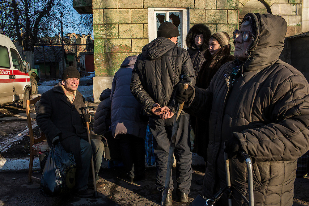 DEBALTSEVE, UKRAINE - FEBRUARY 20: Local residents gather to receive humanitarian assistance on the central square on February 20, 2015 in Debaltseve, Ukraine. Ukrainian forces withdrew from the strategic and hard-fought town after being effectively surrounded by pro-Russian rebels, though fighting has caused widespread destruction. (Photo by Brendan Hoffman/Getty Images) *** Local Caption ***