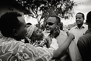 The mayor being kissed by by standers during a music festival he started a year before which got shot up by a clan leader.
