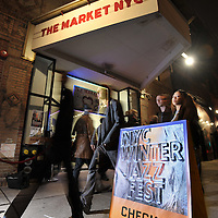 Pedestrians walk by the Will Call check location during the 2013 Winter Jazz Fest on Bleeker Street in Greenwich Village, Friday January 11, 2013.