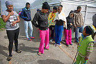 MANENBERG, SOUTH AFRICA - SEPTEMBER 14: Teenagers from the area wait on a street corner on Saturday morning on September 14, 2013 in Manenberg, a township of Cape Town, South Africa. Many are already members of the gang that controls their section of town. In August, 16 schools were closed in the area due to increasing gang violence. An uncertain peace has been brokered between the gangs to help the community resume their daily lives. Photo by Ann Hermes/The Christian Science Monitor