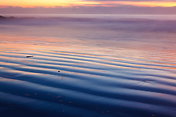 Dawn over the Atlantic Ocean in Wallis Sands State Park, Rye, New Hampshire.