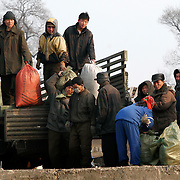 North Korean unload a truck in the bank of the Yalu river in Sinuiju, North Korea, on Wednesday, Feb.  9, 2007. As The Six Party talks resume in Beijing the US envoy is ompimistic on North Korean nuclear talks.