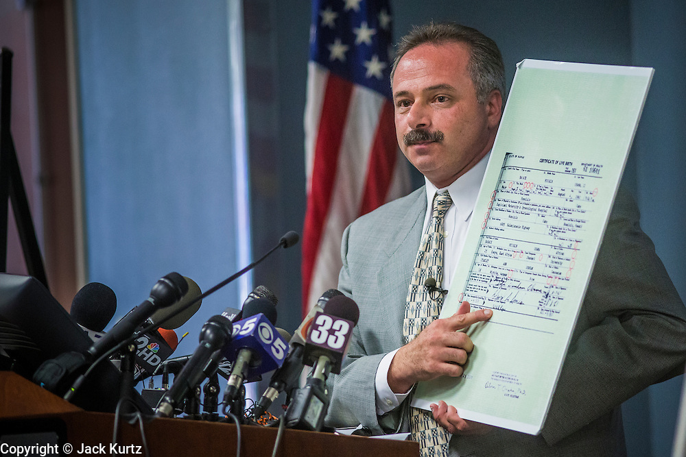 17 JULY 2012 - PHOENIX, AZ: MIKE ZULLO, the volunteer investigator used by Maricopa County Sheriff Joe Arpaio, announces his findings that President Barrack Obama's birth certificate is a fraud. Zullo and Arpaio said their investigation proves that the long form birth certificate President Barrack Obama has used to prove his citizenship is a fraud. They further said that Hawaii's lax standards for getting a birth certificate may pose a serious flaw to the United States' national security. PHOTO BY JACK KURTZ