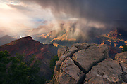 Rain falls from a storm and dances across the landscape of the Grand Canyon.